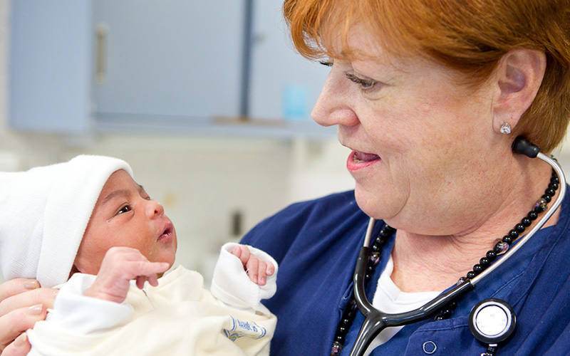 Photo of a nurse with a baby